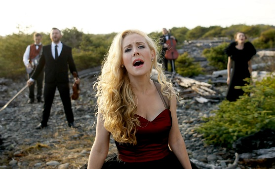 Annie Moses Band singing on beach 558x343