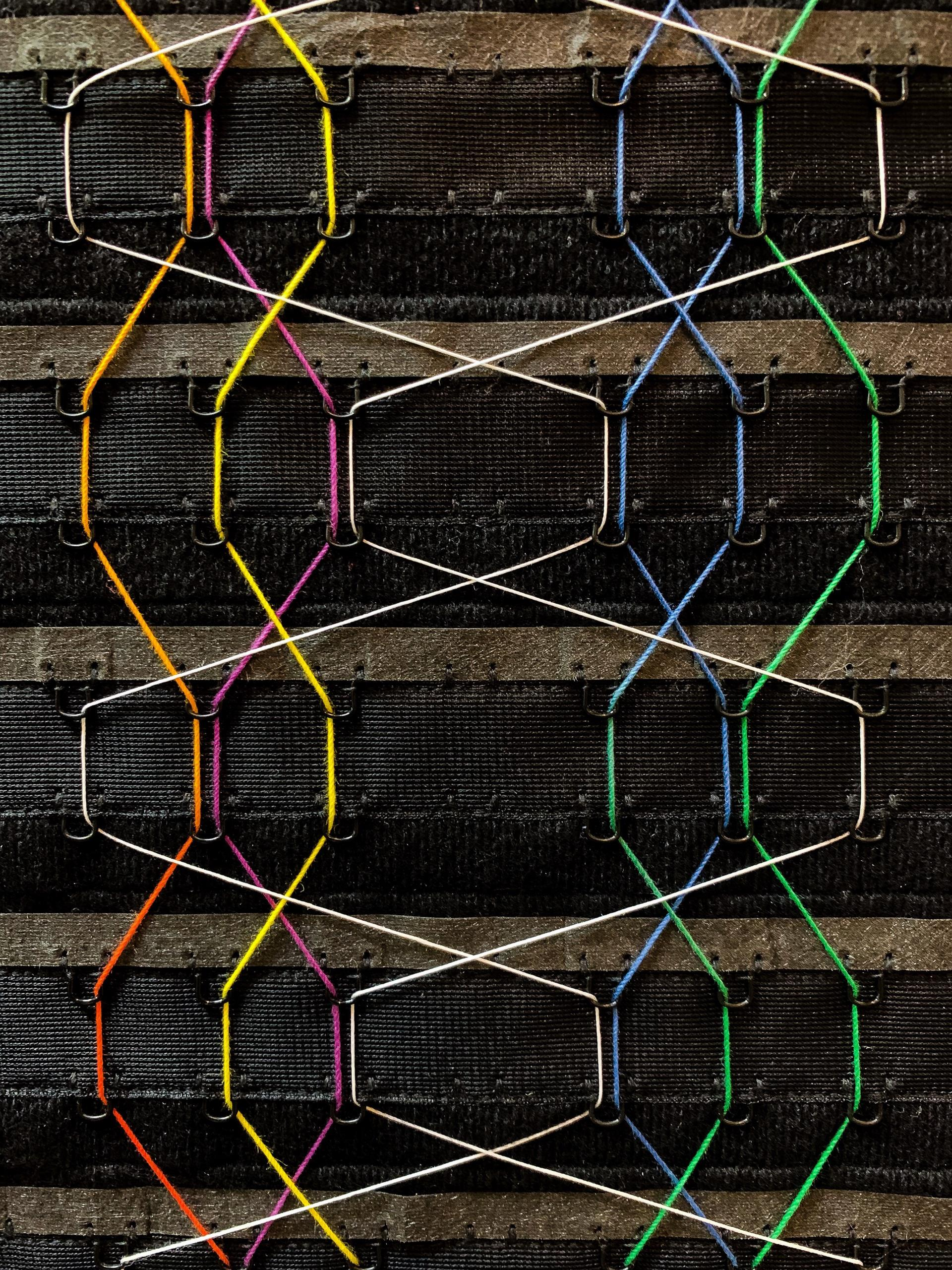 Interwoven threads on a black background